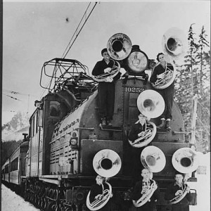 Tubas on a train in black and white photo